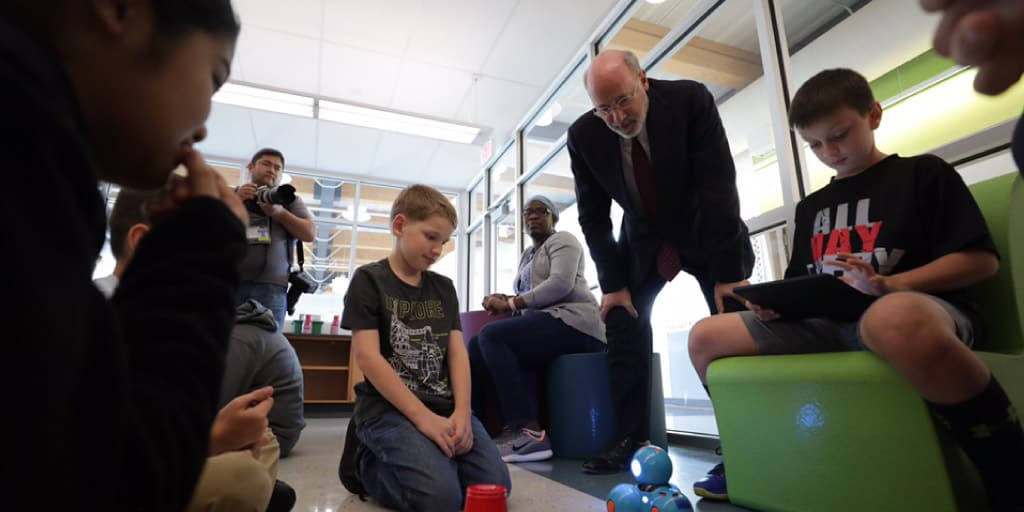 Governor Wolf, speaking with young students.