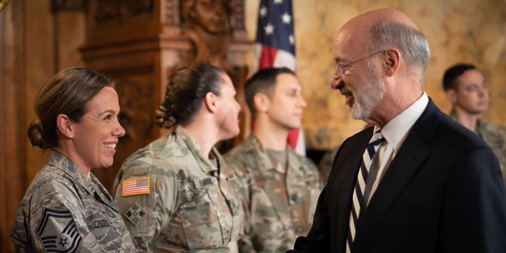 Governor Wolf greets PA Guard member.