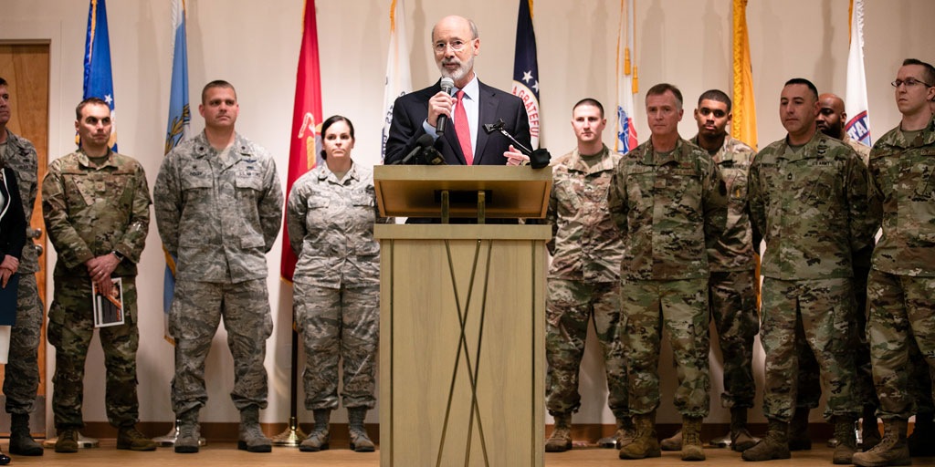Governor Wolf speaks in front of PA Guard Members