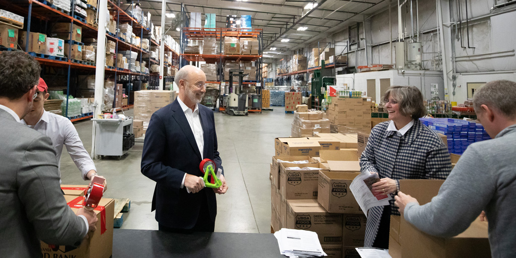 Governor Wolf and First Lady Frances Wolf volunteering at the Central Pennsylvania Food Bank