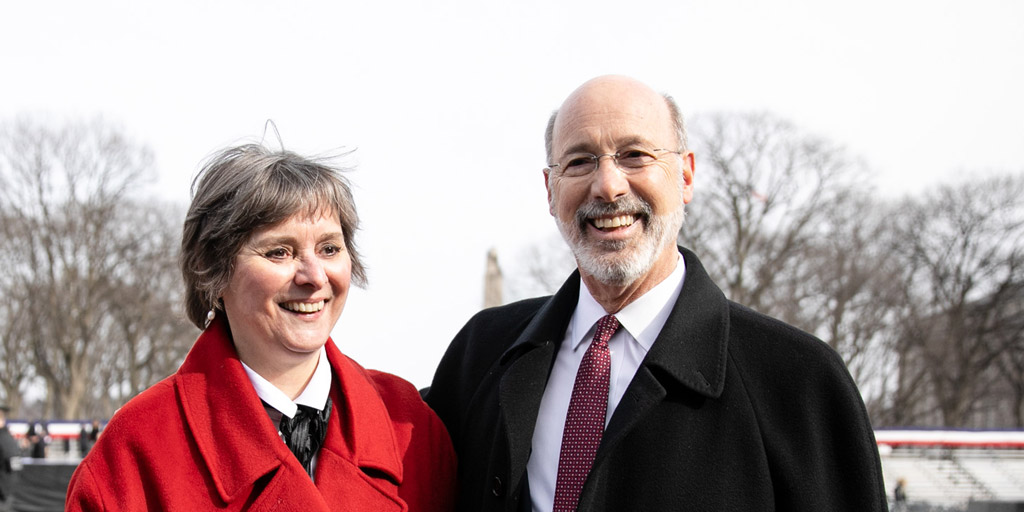 Governor Tom Wolf and First Lady Frances Wolf outside.