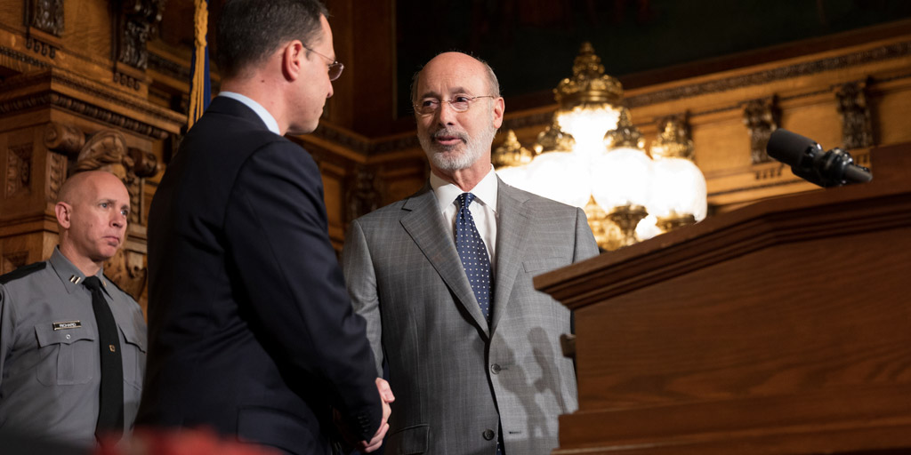 Governor Wolf shakes hands with Attorney General Josh Shapiro