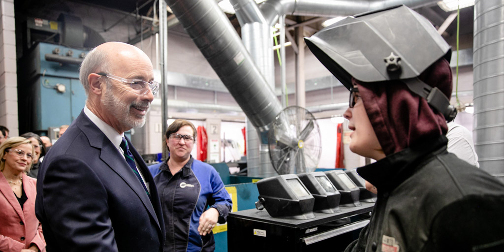 Governor Wolf greets a student welder.