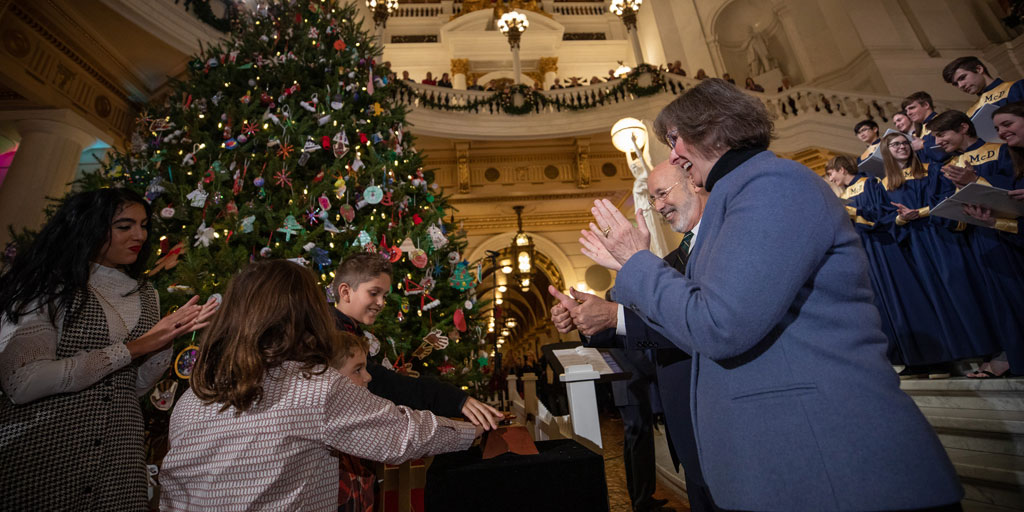Governor Wolf, First Lady Frances Wolf, and the Fetterman Family light the Capitol Christmas Tree.