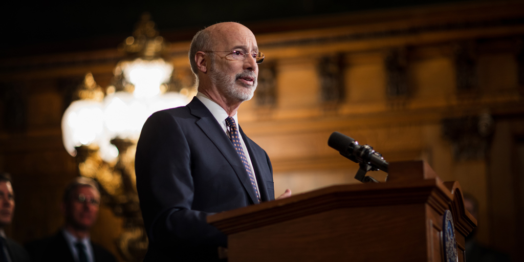 Governor Wolf speaks at a podium.
