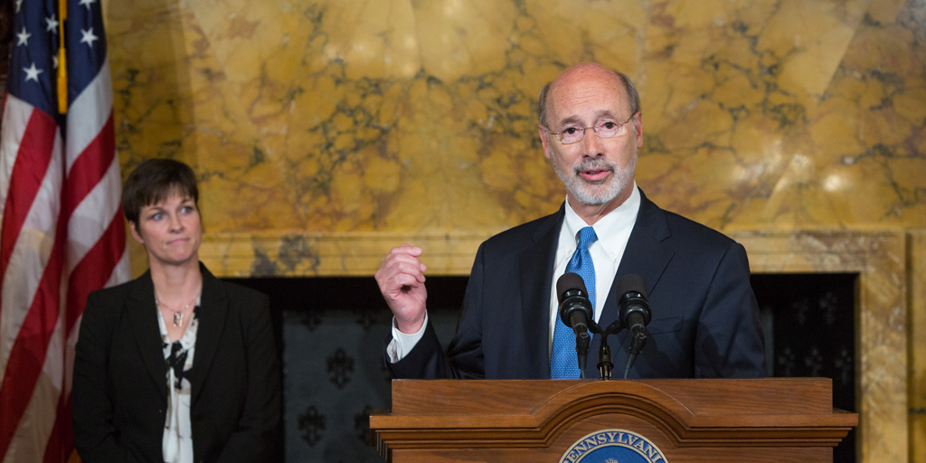 Governor Wolf speaks with Secretary Miller behind him