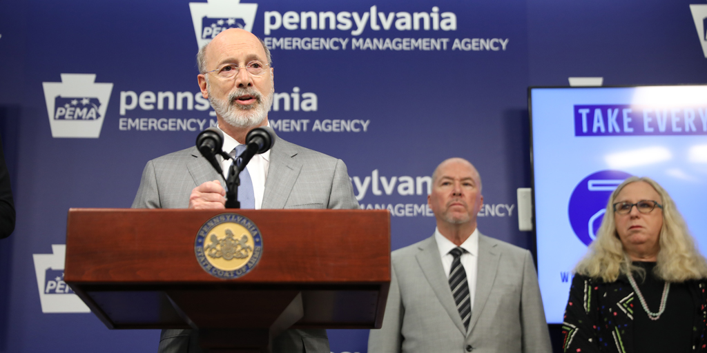 Governor Wolf speaking at a podium at PEMA