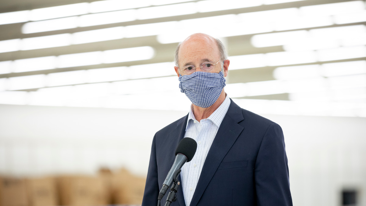 Governor Tom Wolf wearing a mask indoors