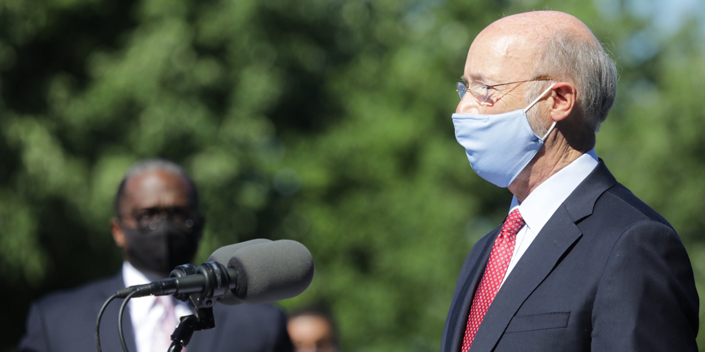 Governor Wolf speaking wearing a mask