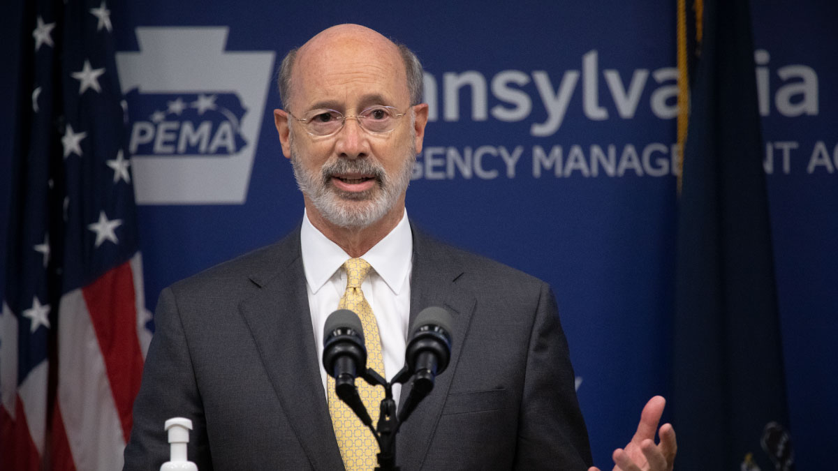 Governor Tom Wolf speaking behind a podium