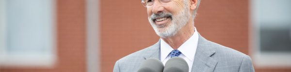 Governor Tom Wolf smiling while speaking outside
