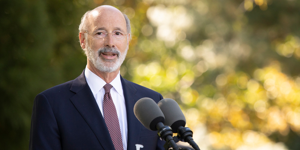 Governor Tom Wolf speaking outside at a podium
