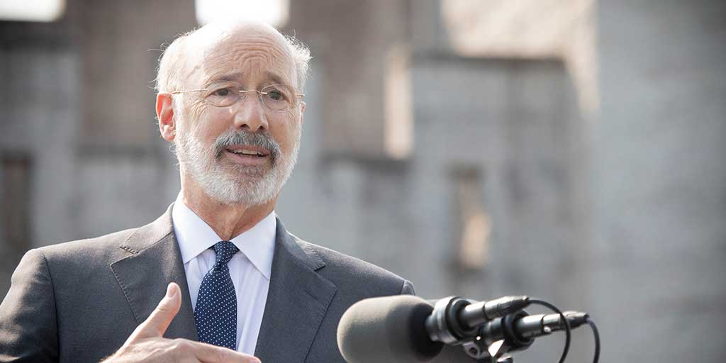 Governor Tom Wolf standing at a podium speaking