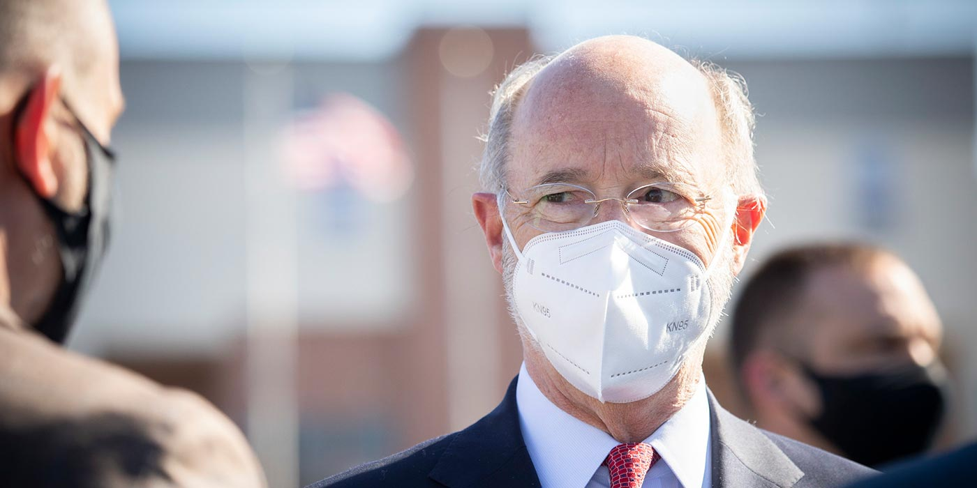 Close up of Governor Tom Wolf wearing a mask