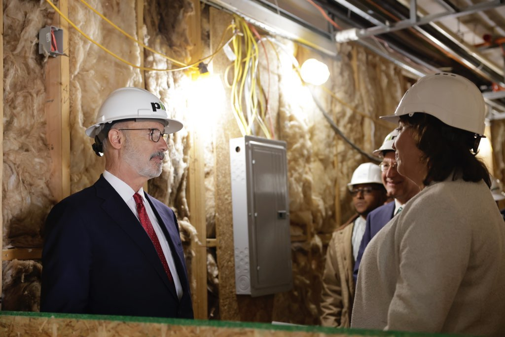 Governor touring construction site of new facility